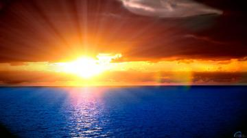 Download Wallpaper Orange sunset in the blue sea 1920 x 1080 HDTV