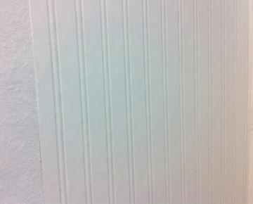 wallpaper on wall Use your sponge to smooth it flat on the wall